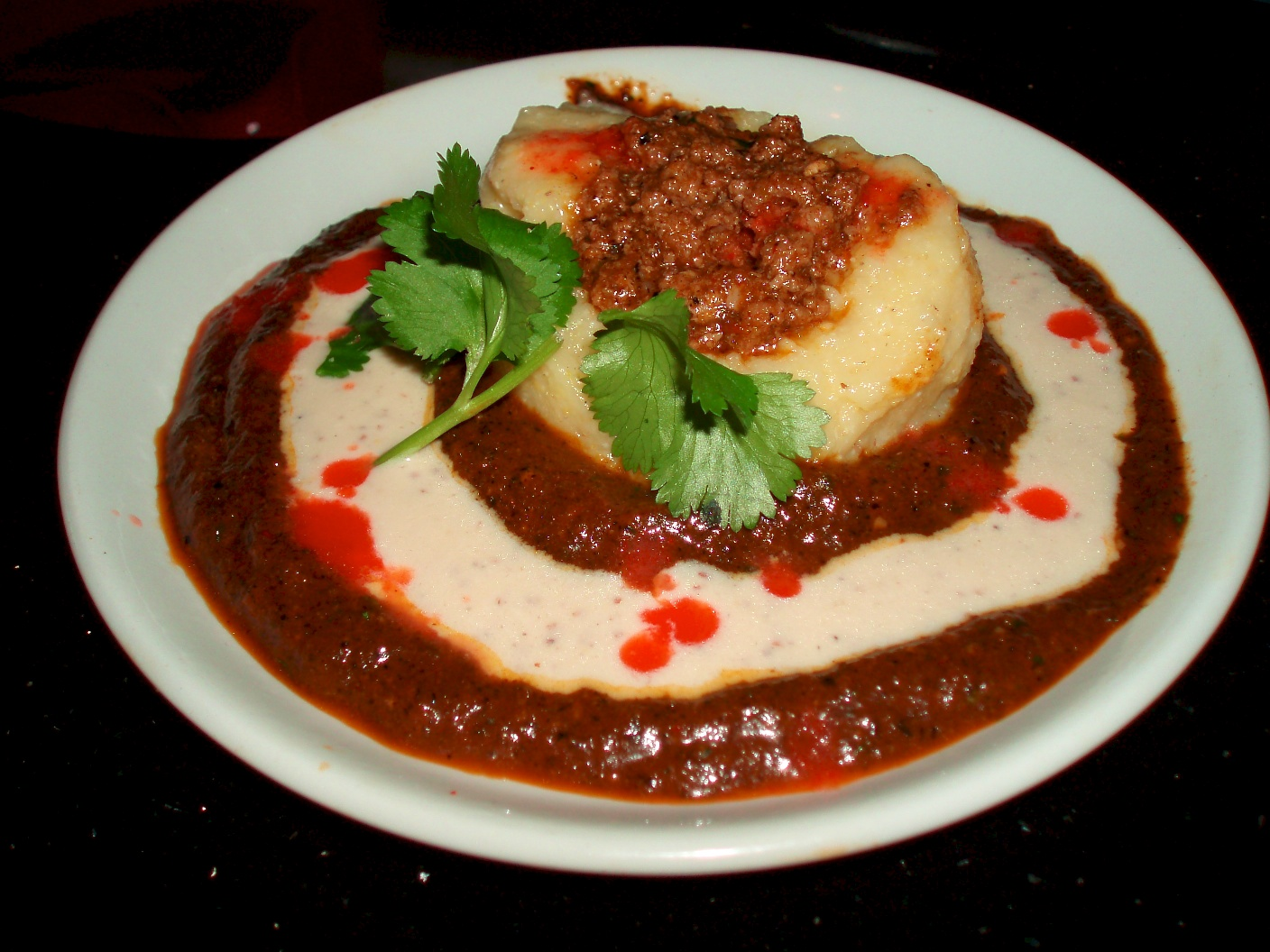 ... Stuffed Polenta Cake with Pasilla Chili Mole and Creamy Jaja Sauce